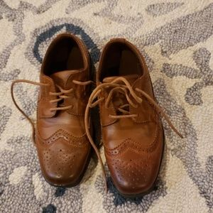 Brown wingtip style dress shoes